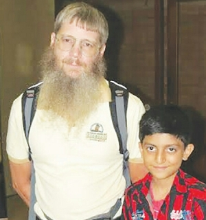 Scrabble prodigy Hasham Hadi seen with world champion Nigel Richards.